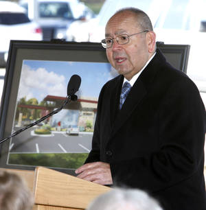Photo - Left: Chickasaw Nation Gov. Bill Anoatubby speaks at a groundbreaking ceremony Thursday for a medical clinic and pharmacy to be built adjacent to Riverwind Casino. PHOTOs BY PAUL HELLSTERN, THE OKLAHOMAN