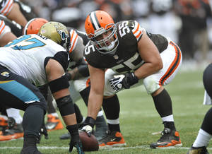Photo - FILE - This Dec. 1, 2013 file photo shows Cleveland Browns center Alex Mack (55) in action during an NFL football game against the Jacksonville Jaguars, in Cleveland. Browns Pro Bowl center Alex Mack's football future could be decided in the next few days _ or hours. The Jacksonville Jaguars are expected to sign Mack to a contract offer sheet on Friday, April 11, 2014. Once the paperwork is filed, the Browns will have five days to match. Cleveland secured that right after placing a $10 million transition tag on Mack before free agency opened. (AP Photo/David Richard, File)
