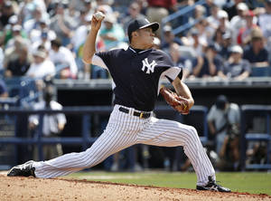 Photo - New York Yankees starting pitcher Masahiro Tanaka delivers in the third inning of a spring exhibition baseball game against the Atlanta Braves in Tampa, Fla., Sunday, March 16, 2014. (AP Photo/Kathy Willens)