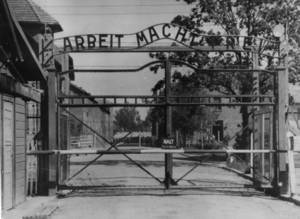 "Photo - FILE - An undated image shows the main gate of the Nazi concentration camp Auschwitz in Poland, which was liberated by the Russians, January 1945. Writing over the gate reads: ""Arbeit macht frei"" (Work Sets You Free). A 93-year-old man who was deported from the U.S. for lying about his Nazi past was arrested by German authorities Monday May 6, 2013 on allegations he served as an Auschwitz death camp guard, Stuttgart prosecutors said. Hans Lipschis was taken into custody after authorities concluded there was ""compelling evidence"" he was involved in crimes at Auschwitz while there from 1941 to 1945, prosecutor Claudia Krauth said. (AP Photo/File)"