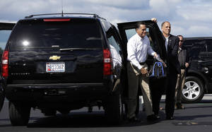 Photo -   Republican presidential candidate Mitt Romney gets out of his vehicle as he boards his campaign charter plane in Bedford, Mass., Monday, Sept. 10, 2012. (AP Photo/Charles Dharapak)