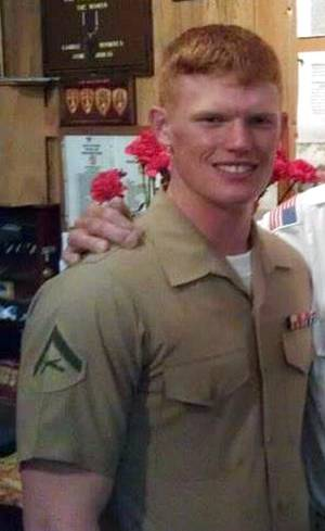 Photo - This undated photo provided by the U.S. Marines shows Lance Cpl. Joshua C. Taylor of Marietta, Ohio. Taylor, 21, was killed with six other Marines in an explosion during a Nevada training exercise on Monday, March 18, 2013. (AP Photo/U.S. Marines)