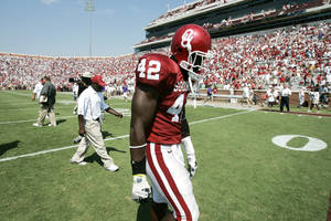 Photo - COLLEGE FOOTBALL, TEXAS CHRISTIAN UNIVERSITY: University of Oklahoma Sooners Rufus Alexander (42) walks off the field after OU's 17-10 loss to TCU, in the 2005 season opener at  The Gaylord Family-Oklahoma Memorial Stadium, in Norman, Oklahoma Saturday, September 3, 2005.   By Bryan Terry/The Oklahoman