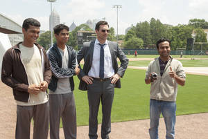 "Photo -  From left, Madhur Mittal, Suraj Sharma, Jon Hamm and Pitobash are shown in a scene from ""Million Dollar Arm."" AP Photo  <strong>Ron Phillips -   </strong>"