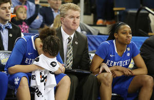Photo - Kentucky guard Makayla Epps, left, sits on the bench with assistant coach Jeff House and teammate Bria Goss, right, in the finals moments of the second half of an NCAA college basketball game against Tennessee  in the finals of the Southeastern Conference women's basketball tournament Sunday, March 9, 2014, in Duluth, Ga. Tennessee  won 71-70. (AP Photo/Jason Getz)