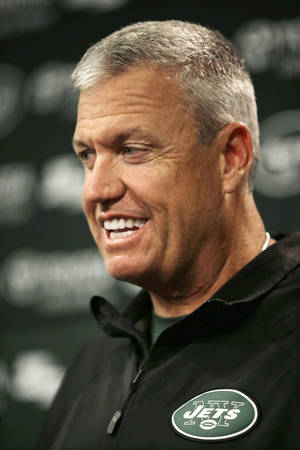 Photo - New York Jets head coach Rex Ryan smiles as he answers a question after the team's NFL football practice in Florham Park, N.J., Monday, Sept. 2, 2013.  (AP Photo/Mel Evans)