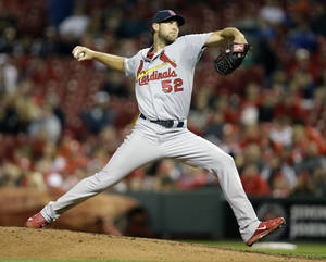 Photo - FILE - In this April 2, 2014 file photo, St. Louis Cardinals starting pitcher Michael Wacha throws against the Cincinnati Reds in the fourth inning of a baseball game, in Cincinnati. Take it from the Reds. Wacha's breakout postseason was no fluke.(AP Photo/Al Behrman, File)