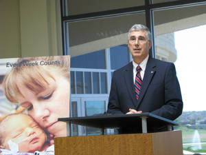 Photo - Craig W. Jones, Oklahoma Hospital Association president, talks about  the mortality rate of state  newborns.