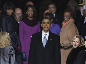 Photo - President Barack Obama pauses with his family at the top of the stairs of the U.S. Capitol after at the ceremonial swearing-in during the 57th Presidential Inauguration in Washington, Monday, Jan. 21, 2013. (AP Photo/Pablo Martinez Monsivais)