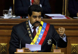 Photo - Venezuela's President Nicolas Maduro speaks during his annual state-of-the-nation address to the National Assembly in Caracas, Venezuela, Wednesday, Jan. 15, 2014. (AP Photo/Fernando Llano)