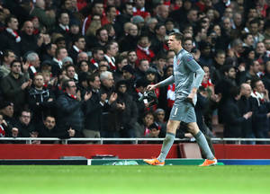 Photo - Arsenal's goalkeeper Wojciech Szczesny leaves the pitch after a red card during a Champions League, round of 16, first leg soccer match between Arsenal and Bayern Munich at the Emirates stadium in London, Wednesday, Feb. 19, 2014 .(AP Photo/Alastair Grant)