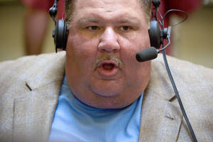 photo - University of Kansas coach Mark Mangino does a radio interview during the Big 12 Conference Football Media Days in Irving, Texas, Tuesday, July 28, 2009. Photo by Bryan Terry, The Oklahoman