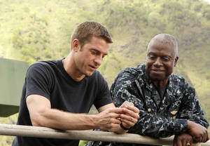 "Photo -   FILE - This publicity file image released by ABC shows Scott Speedman as Sam Kendal, left, and Andre Braugher as Captain Marcus Chaplin in a scene from the series ""Last Resort,"" which premiered on ABC on Sept. 27, 2012. ABC canceled two low-rated new TV series, ""Last Resort"" and ""666 Park Avenue,"" and didn't announce Friday, Nov. 16, 2012, what will replace the two series after they finish airing. (AP Photo/ABC, Mario Perez, file)"