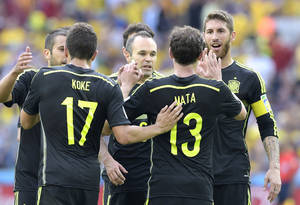 Photo - Spain's Juan Mata celebrates with teammates after scoring during the group B World Cup soccer match between Australia and Spain at the Arena da Baixada in Curitiba, Brazil, Monday, June 23, 2014. (AP Photo/Manu Fernandez)