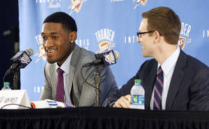 Photo - New OKC Thunder player Perry Jones III is introduced by Thunder General Manager Sam Presti during a press conference at the Thunder's old practice facility in Oklahoma City, OK, Saturday, June 30, 2012,  By Paul Hellstern, The Oklahoman