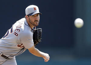 Photo - Detroit Tigers starting pitcher Justin Verlander throws during the first inning of a spring exhibition baseball game against the Atlanta Braves in Kissimmee, Fla., Friday, March 21, 2014. (AP Photo/Carlos Osorio)