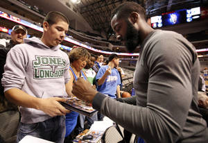 Photo - NBA BASKETBALL / DALLAS MAVERICKS: Brandon Guerra, of Oklahoma City, gets an autograph from James Harden before the preseason NBA game between the Dallas Mavericks and the Oklahoma City Thunder at the American Airlines Center in Dallas, Sunday, Dec. 18, 2011. Photo by Sarah Phipps, The Oklahoman