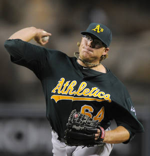 photo -   Oakland Athletics starting pitcher A.J. Griffin throws to the plate during the second inning of their baseball game against the Los Angeles Angels, Wednesday, Sept. 12, 2012, in Anaheim, Calif. (AP Photo/Mark J. Terrill)