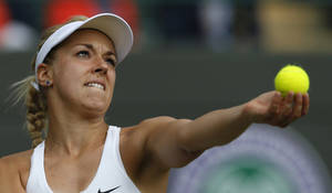 Photo - Sabine Lisicki of Germany prepares to serve to Ana Ivanovic of Serbia during their women's singles match at the All England Lawn Tennis Championships in Wimbledon, London, Monday, June 30, 2014. (AP Photo/Ben Curtis)