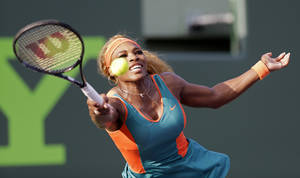 Photo - Serena Williams returns to Yaroslava Shvedova, of Kazakhstan, at the Sony Open tennis tournament in Key Biscayne, Fla., Thursday, March 20, 2014. (AP Photo/Alan Diaz)