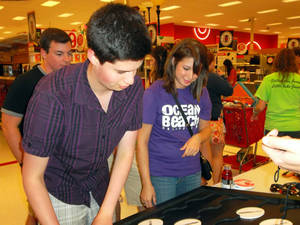 "photo - University of Oklahoma junior Brooke Buchman, 19, of Broken Arrow, and OU sophomore Jonathan Paiz, of Guatemala City, Guatemala, compete Saturday night during a memorization game at the SuperTarget ""Back-To-College"" shopping event in Norman. PHOTO BY KEVAN GOFF-PARKER <strong>Picasa</strong>"