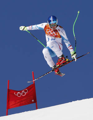 Photo - Austria's Matthias Mayer makes a jump during a men's downhill training run for the Sochi 2014 Winter Olympics, Saturday, Feb. 8, 2014, in Krasnaya Polyana, Russia.(AP Photo)