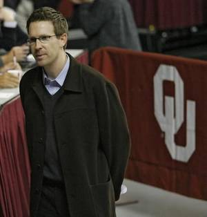 Photo - Oklahoma City Thunder NBA basketball team general manager  Sam  Presti talks with NBA scouts before the preseason NIT college basketball game between the University of Oklahoma (OU) and Davidson University on Tuesday, Nov. 18, 2008 at the Lloyd Noble Center in Norman, Okla. STAFF PHOTO BY CHRIS LANDSBERGER