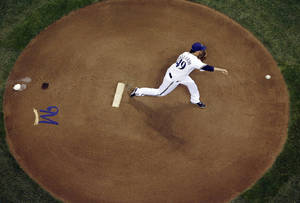 Photo - Milwaukee Brewers starting pitcher Yovani Gallardo throws during the first inning of a baseball game against the Baltimore Orioles on Wednesday, May 28, 2014, in Milwaukee. (AP Photo/Morry Gash)