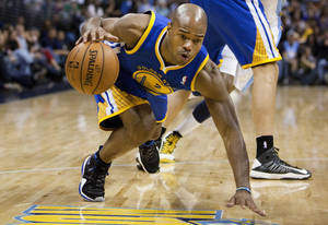 photo -   Golden State Warriors point guard Jarrett Jack (2) stumbles on a play in which Denver Nuggets' Corey Brewer was called for tripping during the first quarter of an NBA basketball game Friday, Nov. 23, 2012 in Denver. (AP Photo/Barry Gutierrez)