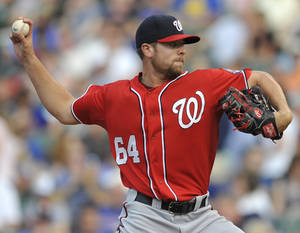 Photo - Washington Nationals starter Blake Treinen delivers a pitch during the first inning of a baseball game against the Chicago Cubs in Chicago, Saturday, June 28, 2014. (AP Photo/Paul Beaty)