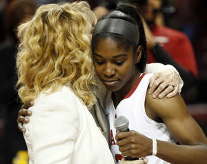 Photo - OU senior Aaryn Ellenberg (3) hugs head coach Sherri Coale during senior night after a women's college basketball game between the Oklahoma Sooners and Texas Tech at Lloyd Noble Center in Norman, Okla., Monday, March 3, 2014. OU won 87-32. Photo by Nate Billings, The Oklahoman