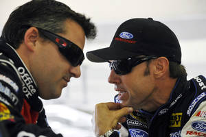 Photo -   Tony Stewart, left, and Matt Kenseth talk in the garage during practice for Sunday's NASCAR Sprint Cup Series auto race at Atlanta Motor Speedway, Friday, Aug. 31, 2012, in Hampton, Ga. (AP Photo/Rainier Ehrhardt)