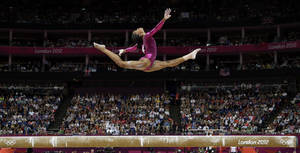 Photo -   U.S. gymnast Gabrielle Douglas performs on the balance beam during the artistic gymnastics women's individual all-around competition at the 2012 Summer Olympics, Thursday, Aug. 2, 2012, in London. (AP Photo/Gregory Bull)