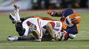 photo - Oklahoma Sooners quarterback Landry Jones (12) is sacked by UTEP&#039;s DeAndre Little (53) during the college football game between the University of Oklahoma Sooners (OU) and the University of Texas El Paso Miners (UTEP) at Sun Bowl Stadium on Sunday, Sept. 2, 2012, in El Paso, Tex.  Photo by Chris Landsberger, The Oklahoman