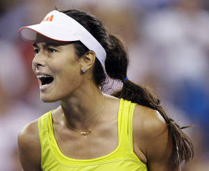 Photo -   Ana Ivanovic, of Serbia, reacts after breaking the serve of Sloane Stephens during a match at the U.S. Open tennis tournament, Saturday, Sept. 1, 2012, in New York. (AP Photo/Darron Cummings)