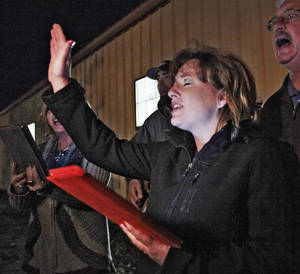 "Photo - Monica Pryor, from left, Brad Pryor, Kari Pryor and Mark Fanning sing during the ""Pray for Rain""  prayer gathering of the Jackson County Ministerial Alliance in Altus. Photo by David McDaniel, The Oklahoman  <strong>David McDaniel</strong>"