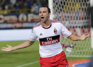 photo -   AC Milan forward Giampaolo Pazzini celebrates after scoring during the Serie A soccer match between Bologna and AC Milan at the Dall'Ara stadium in Bologna, Italy, Saturday, Sept. 1, 2012. AC Milan won 3-1. (AP Photo/Antonio Calanni)
