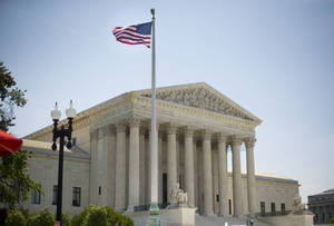Photo - The Supreme Court building in Washington, Monday, June 30, 2014, following various court decisions. The court ruled on birth control, union fees and other cases. (AP Photo/Pablo Martinez Monsivais)