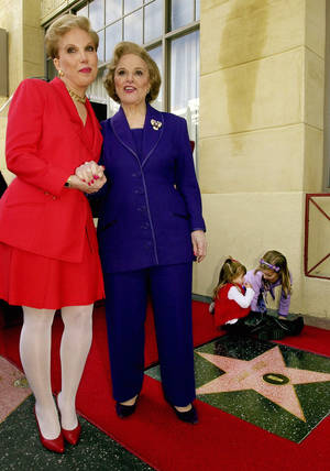 "photo - FILE - In this Feb. 14, 2001 file photo, Pauline Friedman Phillips, right, the nationally-syndicated advice columnist best known as ""Dear Abby,"" and her daughter Jeanne Phillips, pose after the dedication of a Dear Abby star on the Hollywood Walk of Fame in Los Angeles.  Phillips, who had Alzheimer's disease, died Wednesday, Jan. 16, 2013, she was 94.  Phillips' column competed for decades with the advice column of Ann Landers, written by her twin sister, Esther Friedman Lederer. Their relationship was stormy in their early adult years, but later they regained the close relationship they had growing up in Sioux City, Iowa. The two columns differed in style. Ann Landers responded to questioners with homey, detailed advice. Abby's replies were often flippant one-liners. (AP Photo/Reed Saxon)"