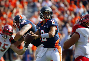 Photo - Illinois quarterback Nathan Scheelhaase (2) looks to throw a pass against Miami (Ohio) during the first half of an NCAA college football game on Saturday, Sept. 28, 2013, at Memorial Stadium in Champaign, Ill. (AP Photo/Jeff Haynes)