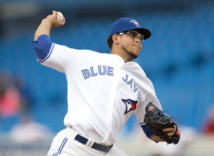 Photo -   Toronto Blue Jays starting pitcher Henderson Alvarez pitches to the Kansas City Royals during the first inning of a baseball game in Toronto on Thursday, July 5, 2012. (AP Photo/The Canadian Press, Frank Gunn)
