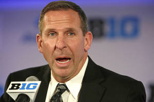 Photo - Nebraska head football coach Bo Pelini speaks at a news conference during the NCAA Big Ten football media day meetings on Wednesday, July 24, 2013, in Chicago. (AP Photo/M. Spencer Green)