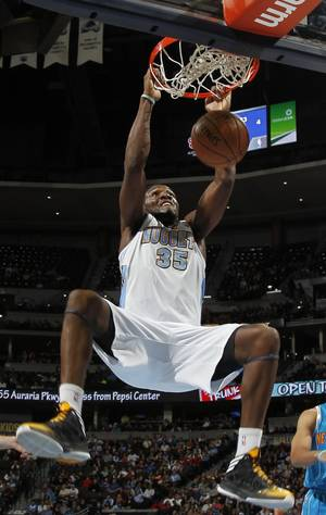 photo - Denver Nuggets forward Kenneth Faried dunks a basket against the New Orleans Hornets in the first quarter of an NBA basketball game in Denver, Friday, Feb. 1, 2013. (AP Photo/David Zalubowski)