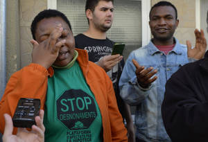 photo -   Perpetua Obi reacts before her eviction in Santa Coloma de Gramanet, Spain, Thursday, Nov. 15, 2012. The Spanish government on Thursday passed a decree suspending evictions of the most vulnerable homeowners unable to pay their mortgage, a bid to ease a trend that has seen hundreds of thousands of people lose their homes because of the brutal economic crisis. The eviction was finally suspended. (AP Photo/Manu Fernandez)