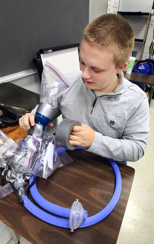 Photo -      Colton Nicholas, 17, works on his team's digestive system project for an anatomy and physiology class at Putnam City High School. Photo by Paul B. Southerland, The Oklahoman  <strong>PAUL B. SOUTHERLAND -   </strong>