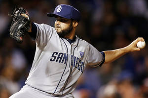 Photo - San Diego Padres relief pitcher Alex Torres delivers against the Chicago Cubs during the seventh inning of a baseball game on Wednesday, July 23, 2014, in Chicago. (AP Photo/Andrew A. Nelles)