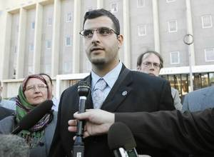 Photo - Muneer Awad speaks to members of the press after a federal judge issued a temporary restraining order against Oklahoma State Question 755 at the Federal Courthouse in Oklahoma City, OK, Monday, Nov. 22, 2010. By Paul Hellstern, The Oklahoman
