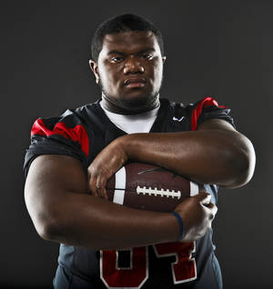 Photo - Little All-City Defensive Player of the Year portrait of Luther defensive tackle Justin Wilson poses for a photo at the OPUBCO studio in Oklahoma City, Okla. on Tuesday, Dec. 20, 2011. Photo by Chris Landsberger, The Oklahoman
