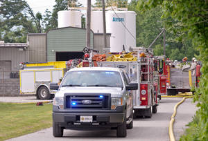 Photo - Putnam County officials respond to the scene where several acetylene cylinders exploded at the Airgas facility in Black Betsy, W.Va., Monday afternoon, May 13, 2013. Fire crews were dispatched at about 3:20 p.m. to Airgas, a distributor of specialty gases, said Jason Owens of Putnam County's emergency management center. He described the injuries to the two as minor and said they were transported to Cabell Huntington Hospital for treatment. A hospital official did not know their conditions. (AP Photo/Daily Mail, Bob Wojcieszak)