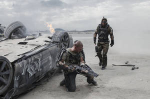 "Photo -  Matt Damon, left, and Sharlto Copley in a scene from ""Elysium.""  TRI STAR/COLUMBIA PICTURES PHOTO     <strong>Stephanie Blomkamp</strong>"